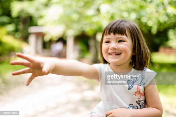 happiness japanese mixed race little girl portrait - little girls giving head stock photos and pictures