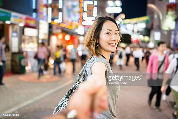 happiness japanese woman in tokyo walking together