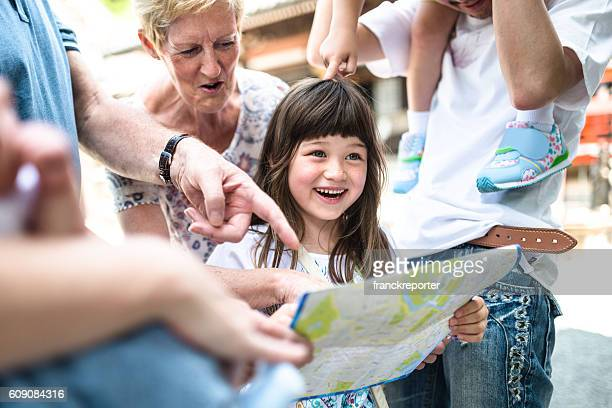 happiness mixed race japanese family looing the map