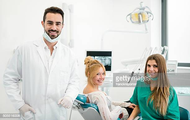 happiness patient at the dentist with the assistant