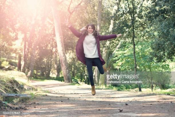 happiness - 若い女性一人 ストックフォトと画像