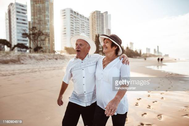 happiness senior couple embracing lovely at dusk - gold coast queensland stock pictures, royalty-free photos & images