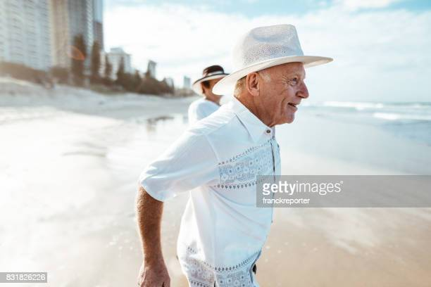 happiness senior couple walking togetherness on the beach