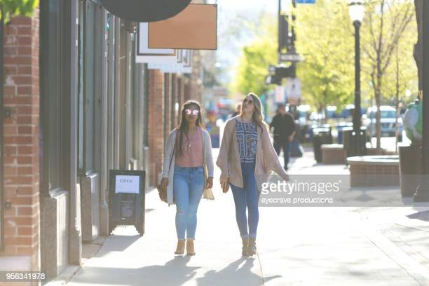 happiness - spring evening in the city young adult college age female best friends - small town america stock pictures, royalty-free photos & images
