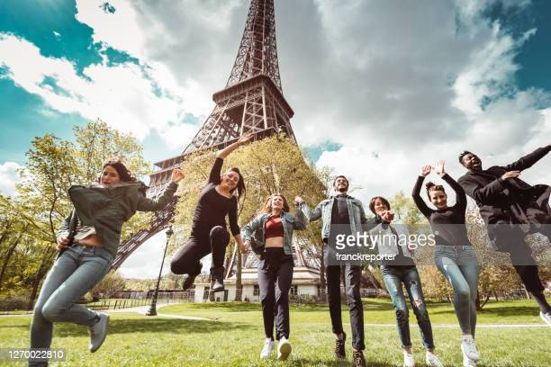 happiness student jumping all together in paris - paris france stock pictures, royalty-free photos & images