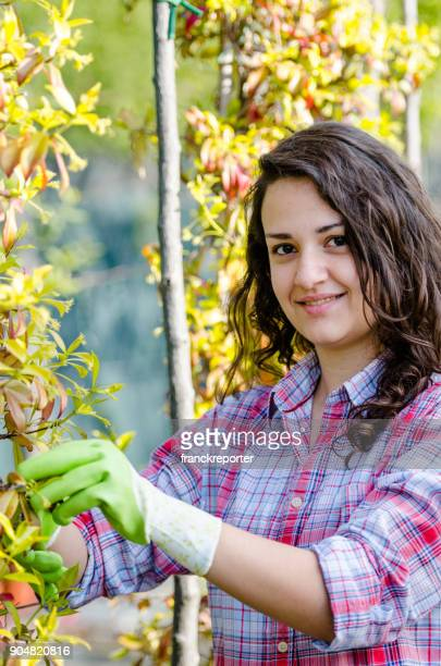 happiness woman pruning the branches