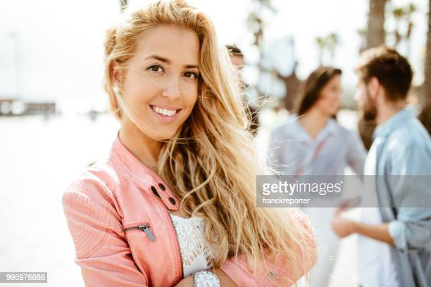 happiness woman stands out from the friends