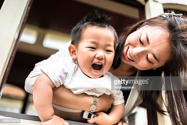 happiness young mother with his son have fun