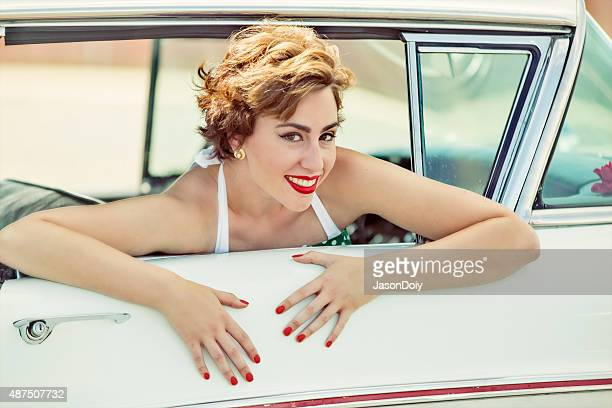 Happy 1950s  Woman Smiling and Lauging in a Vintage Car