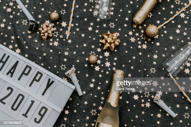 happy 2019 message in lightbox in golden party background.top view - 2019 stock pictures, royalty-free photos & images