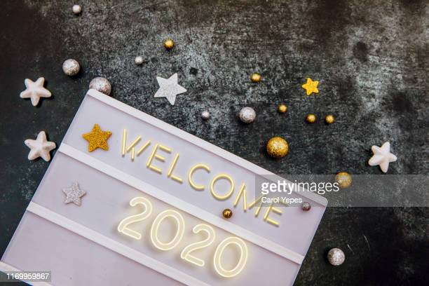 happy 2020 message in lightbox in golden party background.top view - new year 2020 stock photos and pictures