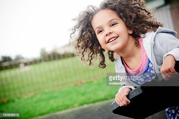 happy 4 years old girl on the swing - 4 5 years stock pictures, royalty-free photos & images