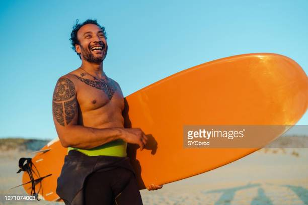 happy 40 years old surfer portrait - france stock pictures, royalty-free photos & images