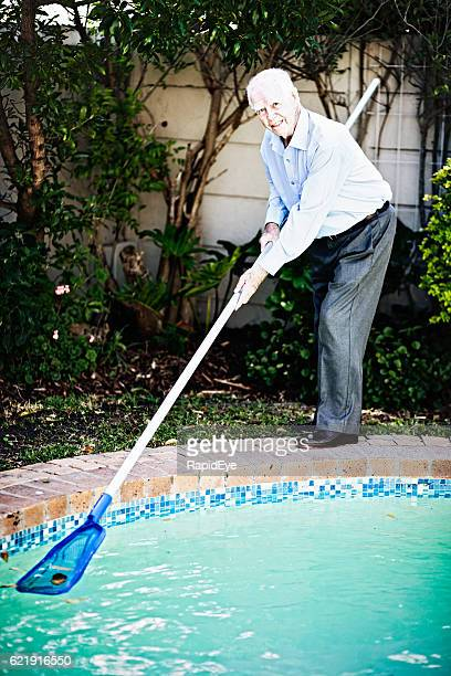 Happy 90-year-old man keeps fit by cleaning swimming pool