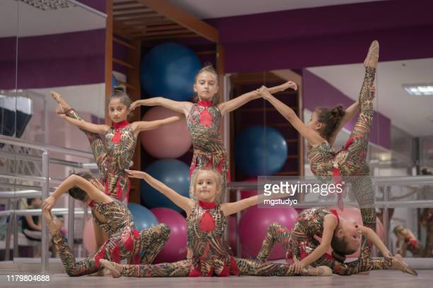 happy acrobatic dancers posing on camera - floor gymnastics stock pictures, royalty-free photos & images