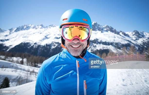 Happy adult man skiing