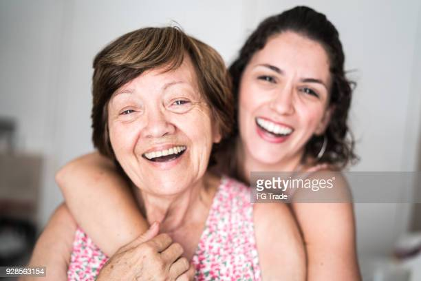 happy adult mother and daughter embracing - mother daughter stock photos and pictures