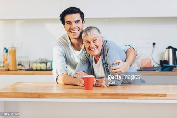 happy adult mother and son - mother and son stock photos and pictures