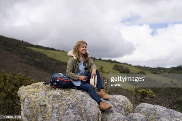 happy adult woman hiking and enjoying nature - binoculars stock pictures, royalty-free photos & images