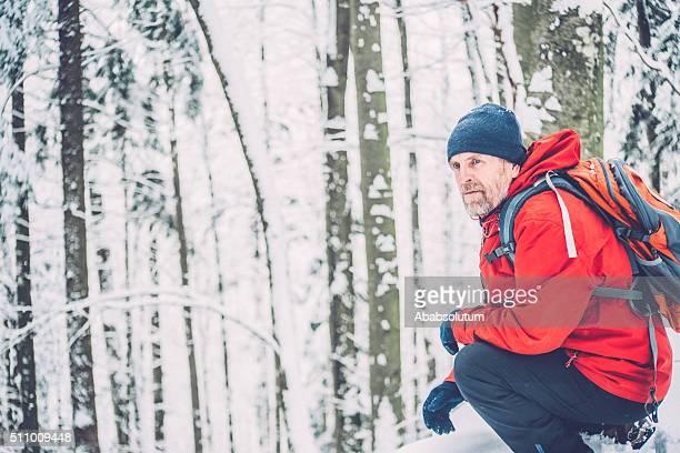 Happy Adventurous Senior Man Hiking in Forest, Snowing,  Alps, Europe