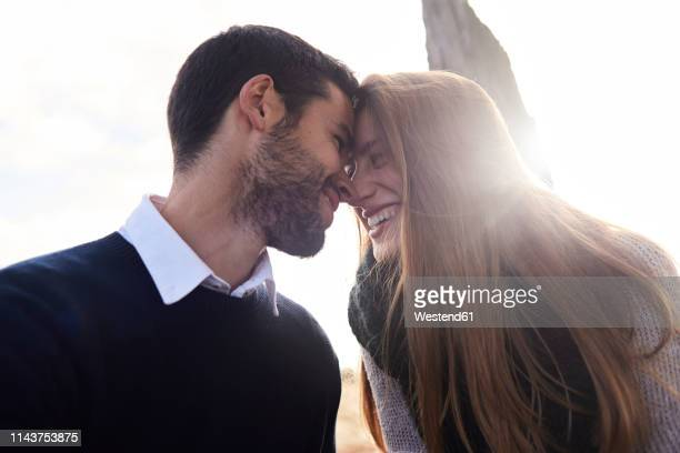 happy affectionate couple outdoors - love stock pictures, royalty-free photos & images