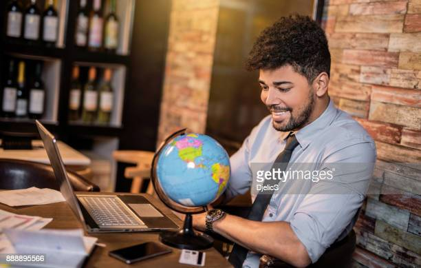 Happy African American businessman planning to travel
