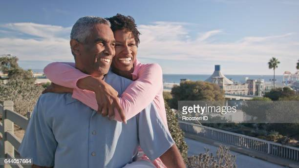 Happy African American Couple Embrace on Beach Boardwalk