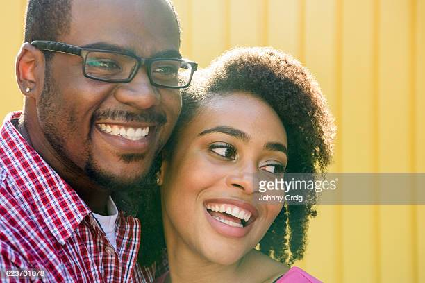 Happy African American couple smiling and looking away