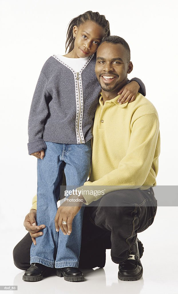 happy african american dad on his knees with daughter : Foto de stock
