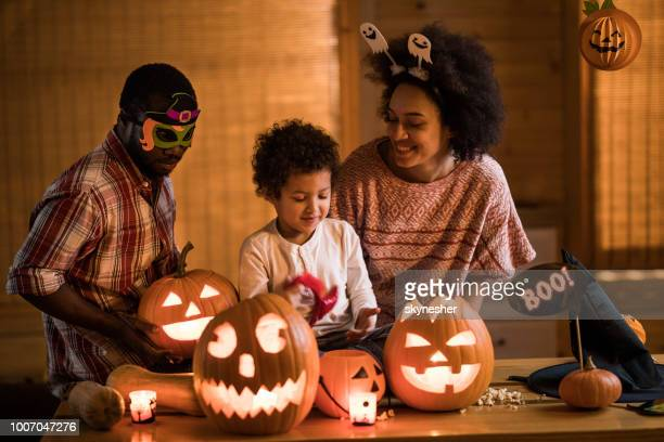happy african american family enjoying in halloween at home. - happy halloween stock photos and pictures