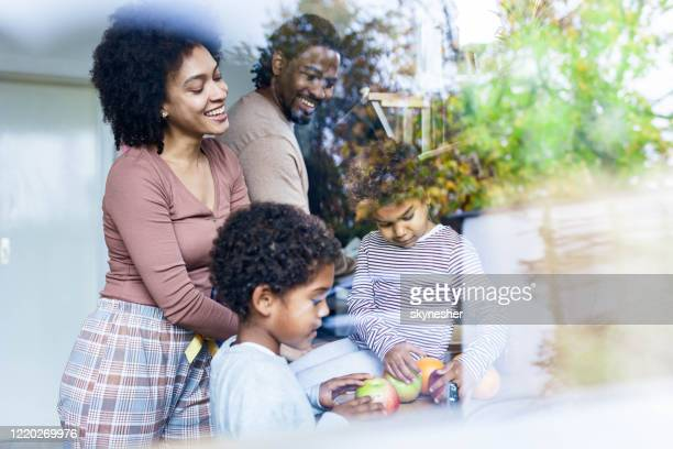 happy african american family preparing breakfast in the morning. - sunday stock pictures, royalty-free photos & images