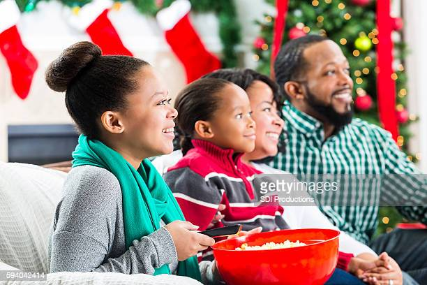 happy african american family watch a christmas movie - southern christmas stock pictures, royalty-free photos & images