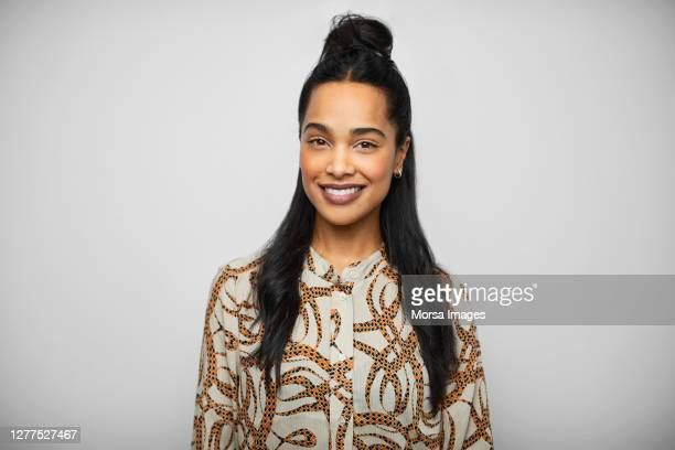 happy african american female ceo wearing printed blouse. - business casual stock pictures, royalty-free photos & images