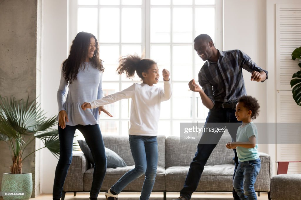 Happy African American having fun together indoors : Stock Photo