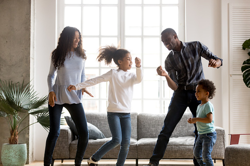 Happy African American having fun together indoors 1085009306