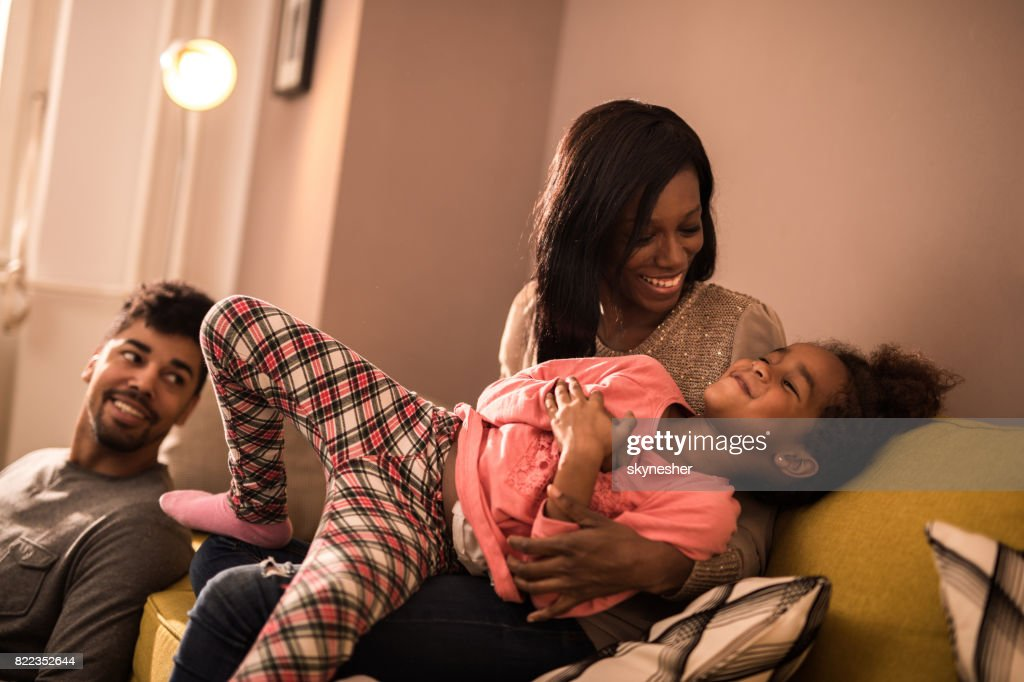 Happy African American mother and daughter having fun at home. : Stock Photo