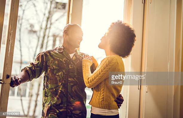 happy african american soldier coming home to his wife. - military spouse stock pictures, royalty-free photos & images