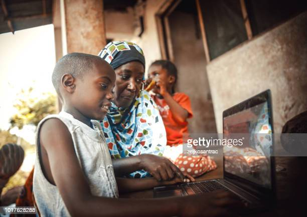 happy  african family  together using laptop - africa stock pictures, royalty-free photos & images