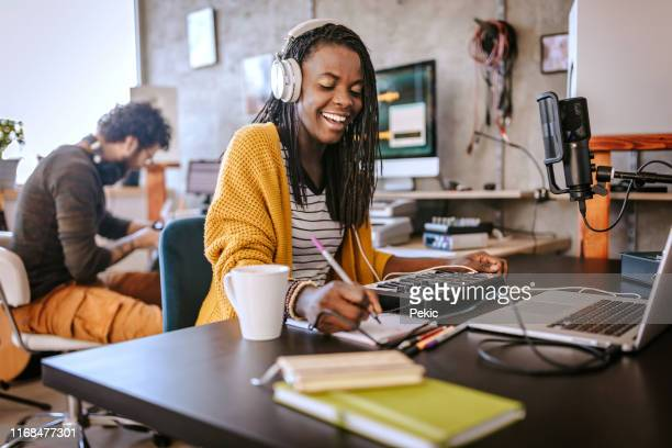 happy african female radio host broadcasting in studio - producer stock pictures, royalty-free photos & images