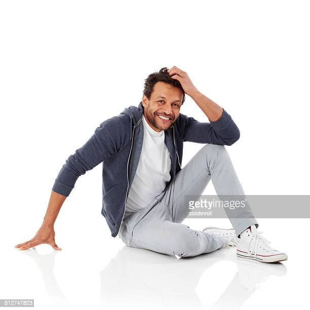 Happy african man sitting over white background