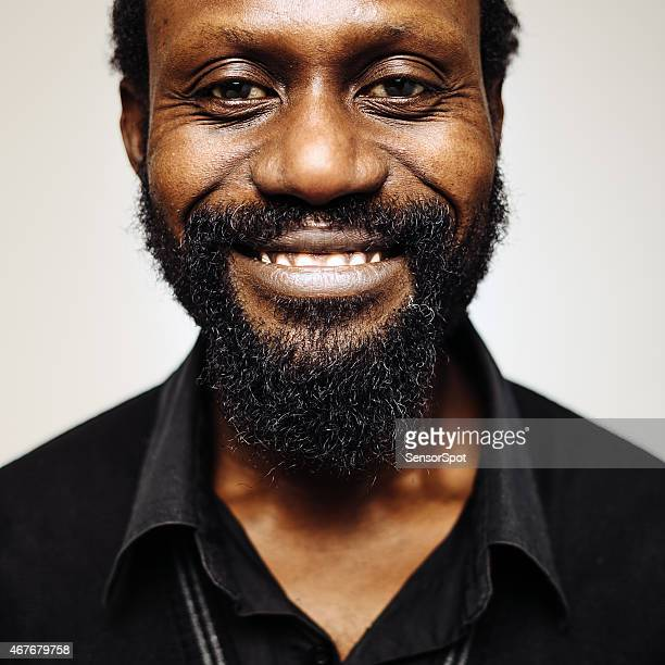 Happy african mid age man portrait with beard smiling.