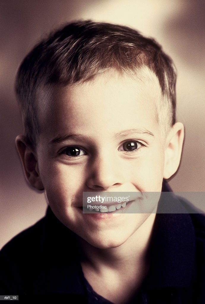 Happy Africanamerican Boy With Big Brown Eyes And Very Short Black
