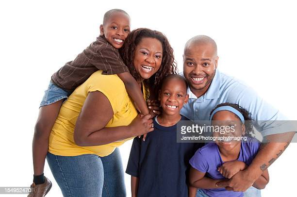 Happy African-American family with three young children
