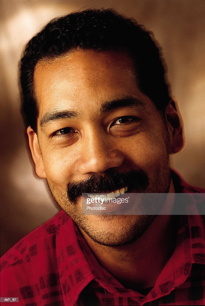 happy african-american man with mustache wearing red plaid shirt smiles : Stockfoto