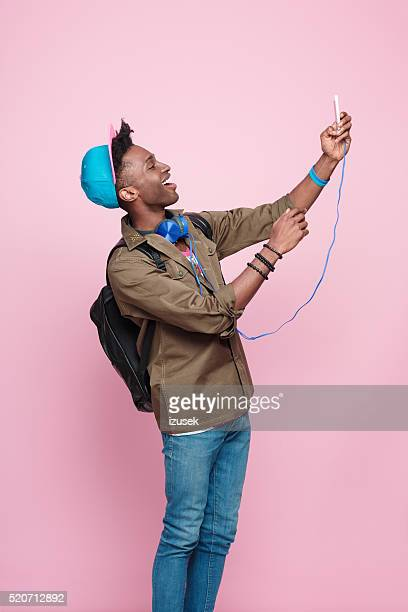 Happy afro american guy wearing headphone