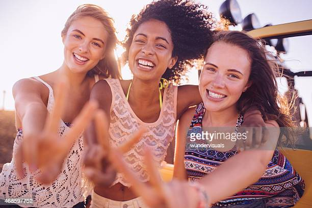 Happy Afro girl and friends smiling showing peace sign