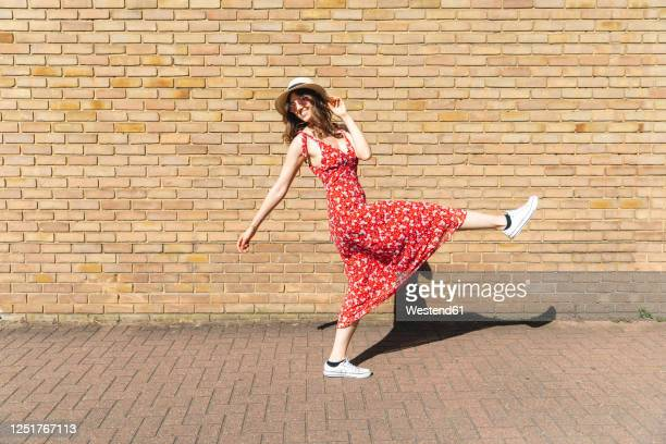 happy and carefree young woman outdoors - full length stock pictures, royalty-free photos & images