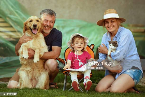 a happy and complete family! - cat with red hat stock pictures, royalty-free photos & images
