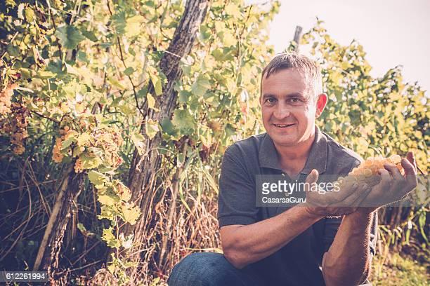 Happy and Proud Farmer Portraitin his Vineyard