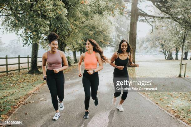 happy and relaxed woman joggers - {{relatedsearchurl(carousel.phrase)}} stock pictures, royalty-free photos & images